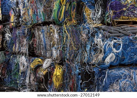 Bales of CAT5 cables. There is a mix of plastic and copper to recover. - stock photo