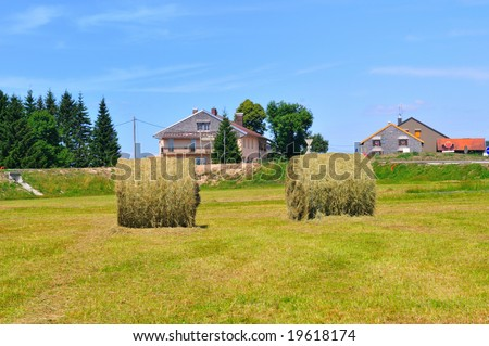 Bales of Hay in the fields at the French Alps