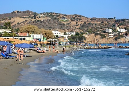 BALI, CRETE - SEPTEMBER 16, 2016 - Tourists relaxing on Livadi Beach with restaurants to the rear, Bali, Crete, Greece, Europe, September 16, 2016.