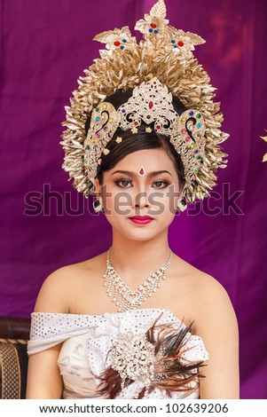 BALI - FEBRUARY 11. Woman enacting wedding scene in preparation for religious ceremony on February 11, 2012 in Bali, Indonesia. Most Balinese get married in their early 20s. - stock photo