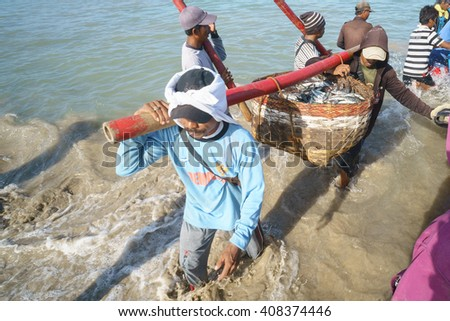 Bali Indonesia Apr 5, 2016 : Morning scene of daily activities at Jimbaran village pictured on Apr 5, 2016 in Bali Indonesia. Jimbaran village is among famous place to see fisherman life in Bali. - stock photo
