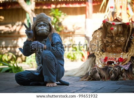BALI, INDONESIA - APRIL 9: Monkey and Barong during a classic national Balinese dance Barong on April 9, 2012 on Bali, Indonesia. Barong is very popular cultural show on Bali. - stock photo