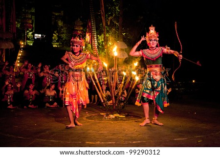 BALI, INDONESIA - APRIL 4: Presentation of traditional balinese Women Kecak Fire Dance on April 4, 2012 on Bali. Kecak (also known as Ramayana Monkey Chant) is very popular cultural show on Bali. - stock photo