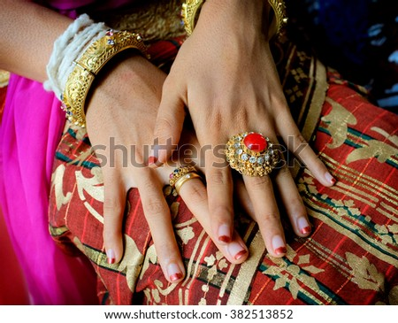 BALI, INDONESIA - July 21, 2014: A 19-year-old Asian bride shows off her large wedding ring and jewelry during her Balinese-Hindu marriage ceremony on July 21, 2014 in Ubud, Bali, Indonesia.