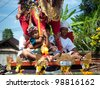 BALI, INDONESIA, JULY 14: unidentified Balinese children participate at the parade during the cremation ceremony in Penestanan, Bali on July 14th 2010. - stock photo