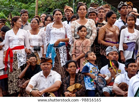 BALI, INDONESIA, JULY 14: unidentified Balinese people participate at the cremation ceremony in Penestanan, Bali on July 14th 2010.