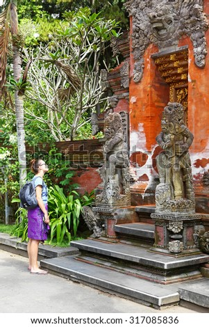 BALI, INDONESIA - JUN 19 : Unidentified Tourists visit at sacred springs water temple of Tirta Empul on June 19, 2015 in Bali, Indonesia. It is a to pray cleanse religious ceremony of Balinese - stock photo