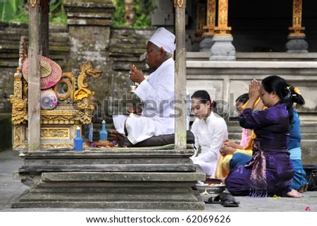 BALI, INDONESIA - JUNE 22: A group of Hindu believers came to the 2nd biggest Hindu temple in Bali Island to pray and to give offering to God, June 22, 2010 in Bali, Indonesia. - stock photo