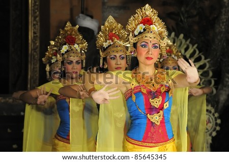 """BALI, INDONESIA - MAY 4: Balinese tradition dance """"Legong and barong dance"""" is performed by the sekehe Gong Panca Artha dance group for tourists on May 4, 2011 at Ubud Place in Ubud, Indonesia. - stock photo"""