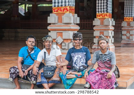 BALI, INDONESIA - NOVEMBER 3RD 2014 :  Balinese people smile for the camera at Tirtha Empul Bali, Indonesia. - stock photo