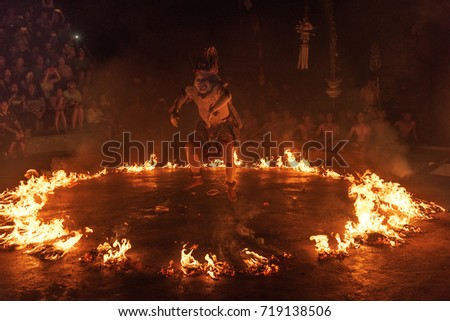 Bali, Indonesia - October 2015: Monkey God set to fire during one of the act during Uluwatu Kecak and Fire Dance, Bali, Indonesia