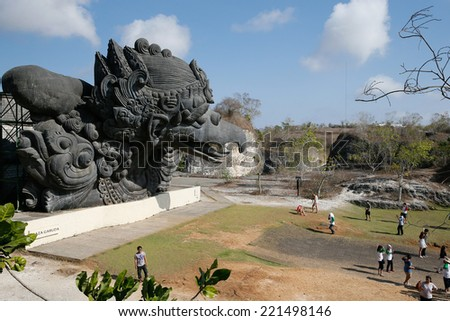 BALI, INDONESIA - SEPTEMBER 19, 2014: Tourists visit the giant monument of Garuda, a mystical bird at the Garuda Wisnu Kencana at Uluwatu, Bali Island. Bali is a world famous tourist destination. - stock photo