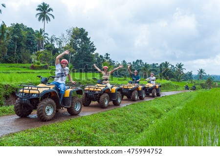 BALI ISLAND, INDONESIA - AUGUST 25, 2008: Group of tourists driving quadrocycle jungles safari