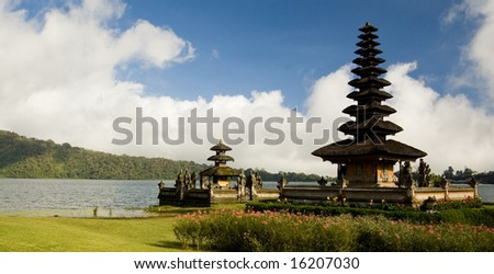 Bali's Batur temple on the lake, though water has receded and it is on dry land. - stock photo