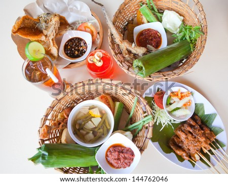 Bali traditional food, chicken, fish, vegetables - stock photo