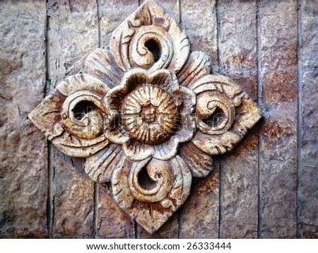 Balinese stone carving on sandstone - stock photo