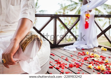balinese wedding ceremony with flowers background - stock photo