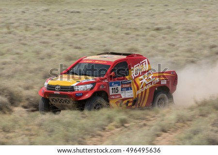 BALKHASH, KAZAKHSTAN-JULY 14, 2016: Sports car gets over the difficult part of the route during the Silk Way rally Moscow-Beijing Dakar series on a dirt road