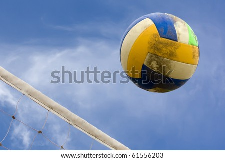 ball and net for beach volleyball with sky as background - stock photo