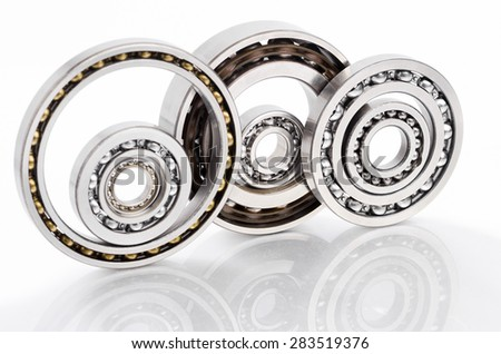 Ball bearing on reflected surface and white background