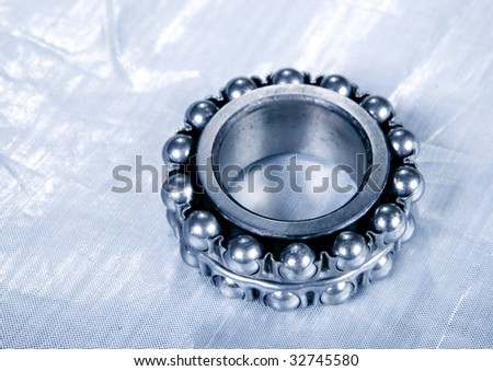 ball bearing on silver diagram isolated