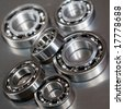 Ball-bearings on a polished steel surface - stock photo