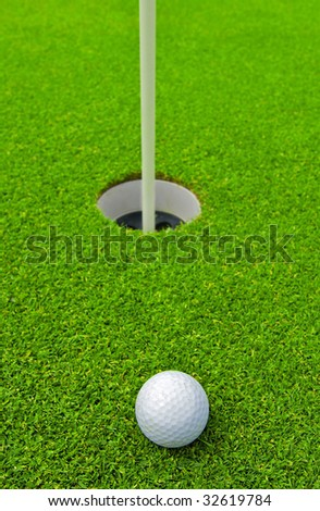 Ball for a golf on a green grass - stock photo