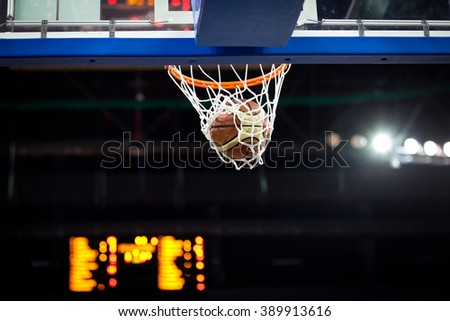 Ball in hoop - stock photo