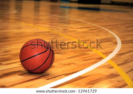 Ball in school sport hall - stock photo