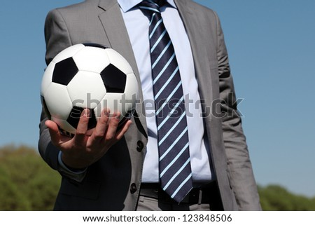 ball in the hand of a coach - stock photo