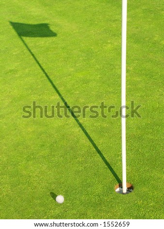 Ball near the target on the Golf-Field - stock photo