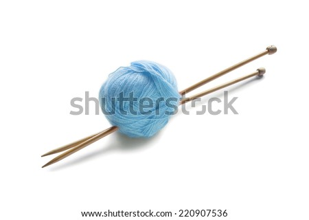 Ball of blue mohair yarn with pair of wooden needles isolated over white - stock photo