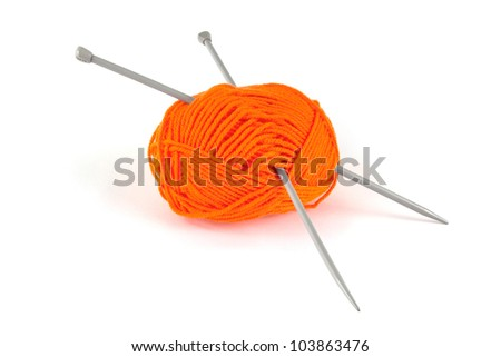 Ball of orange wool with knitting needles over white - stock photo