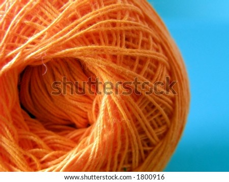 Ball of orange yarn. - stock photo