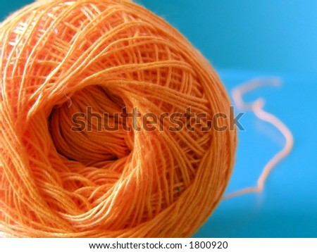 Ball of orange yarn.