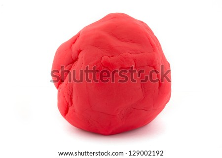 Ball of red play dough over white - stock photo