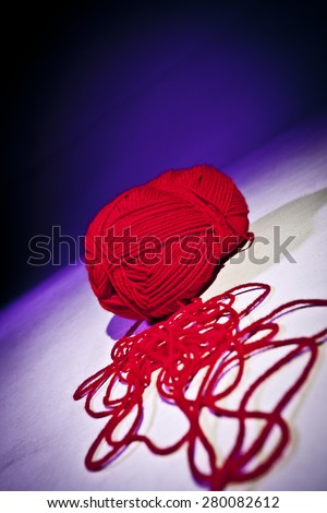Ball of red wool - stock photo