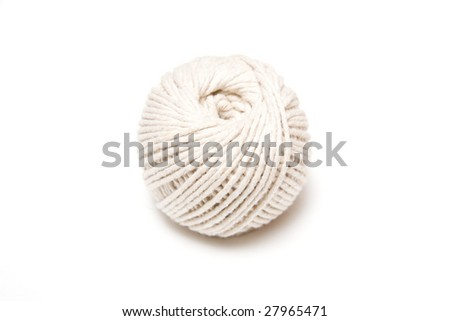 Ball of string isolated on a white studio background.