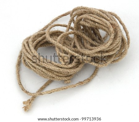 Ball of string or twine on a white background. - stock photo
