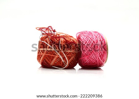 ball of thread and sewing needle, on a white background - stock photo
