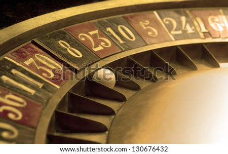 Ball on and old roulette with numbers - stock photo