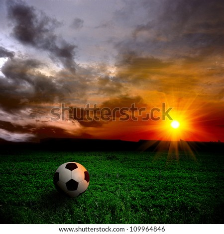 ball on the field at sunset - stock photo