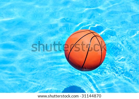 Ball on the float at the swimming pool - stock photo