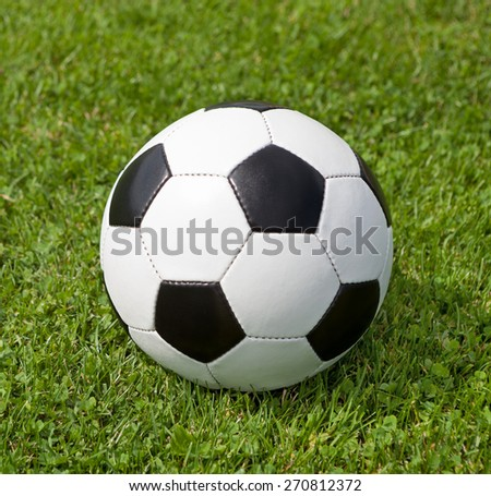 Ball on the soccer field - stock photo