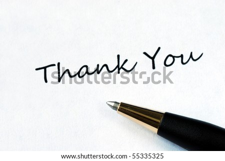 Ball pen on white background showing Thank You - stock photo