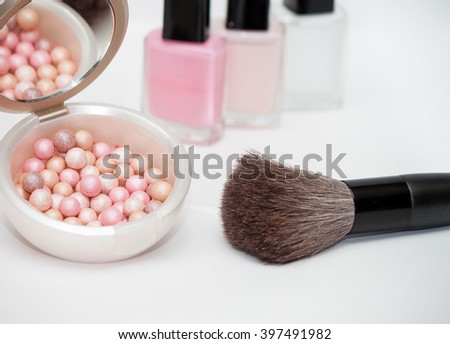 ball rouge with brush and pinkish nail polish  isolated on white background
