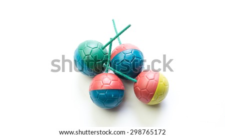 Ball shaped high exploding firecrackers with brimstone gunpowder or locally known as Mercun Bola in Malaysia. Concept of dangerous firecracker. Isolated on white background. Copy space.  - stock photo