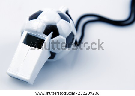Ball whistle on plain background