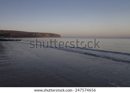 Ballard Down at low tide in the evening light - stock photo