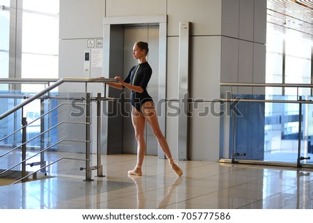 Ballerina  from the theater in the waiting room at the airport